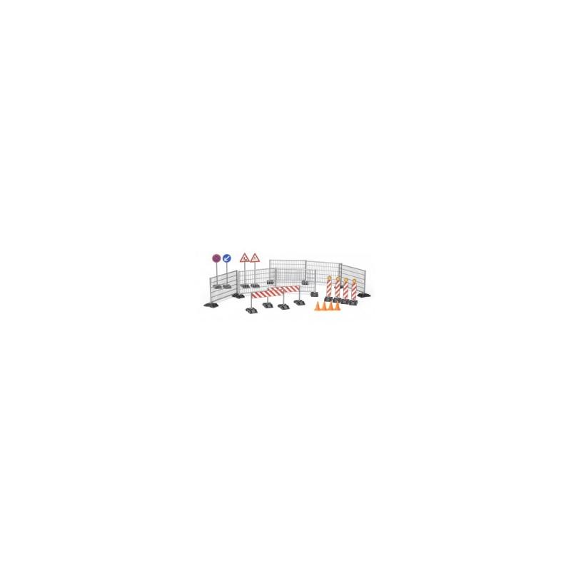 Accessoires de chantier avec panneaux de signalisation et plots au v