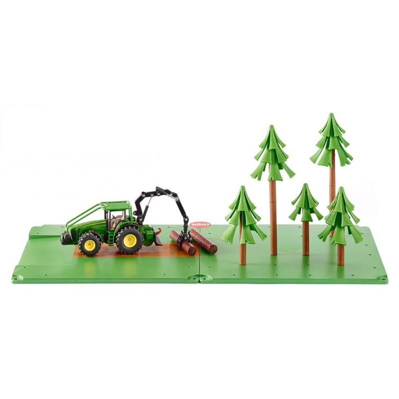 Tracteur forestier et forêt John Deere
